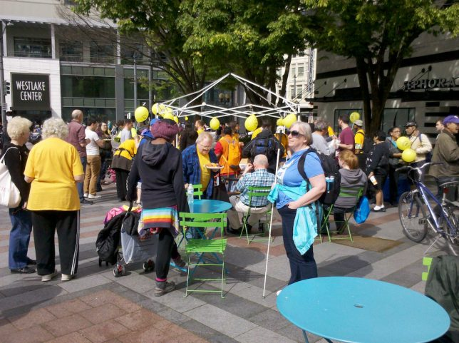 Transit Riders partake in a community meal at Westlake Park before riding the train.